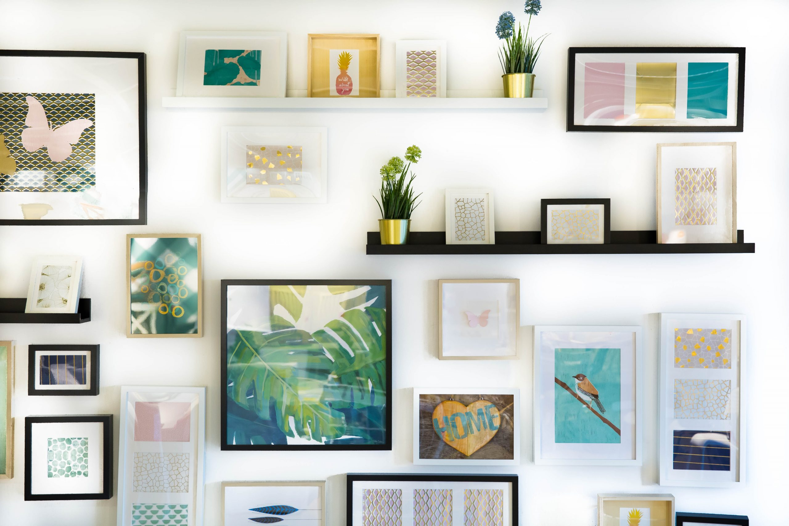 Picture of apartment wall with art for article featuring The Best Artists to Help Decorate Your Apartment