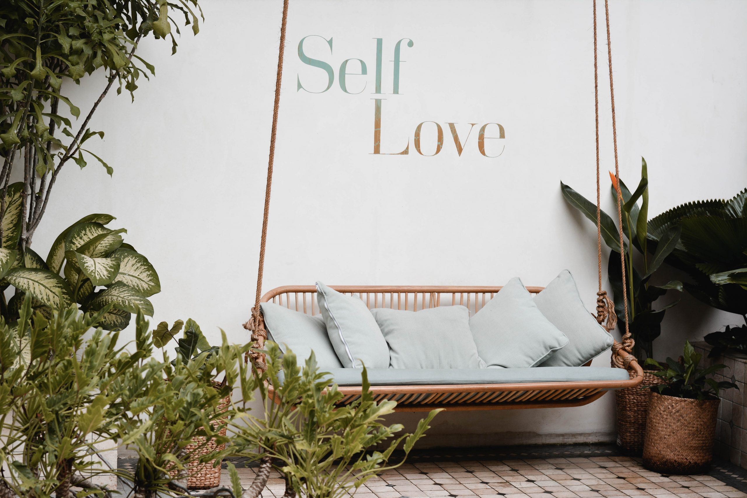 """Couch with """"self love"""" on all for article how to start loving yourself"""