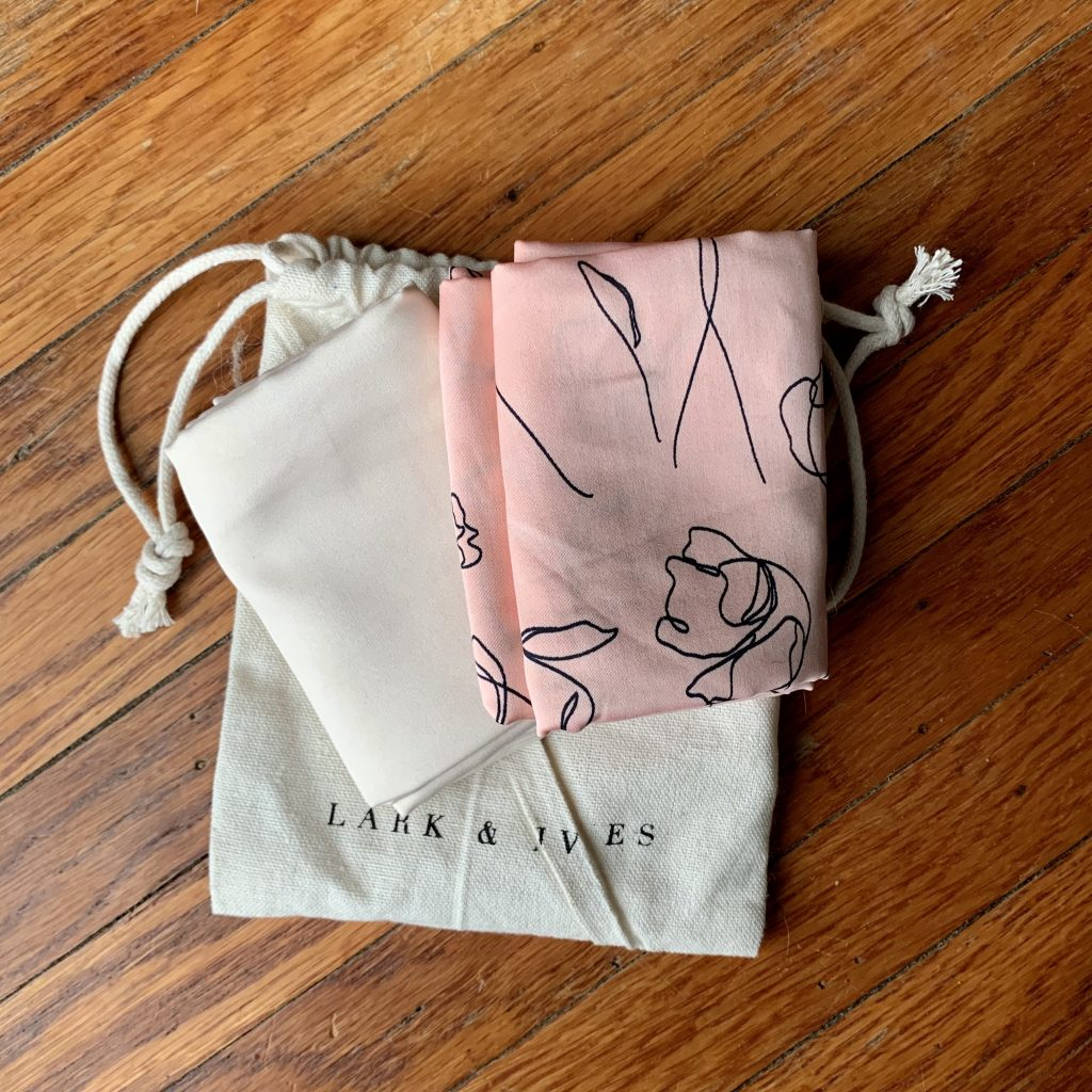 2 Folded Hair Scarves one beige and one pink with black prints