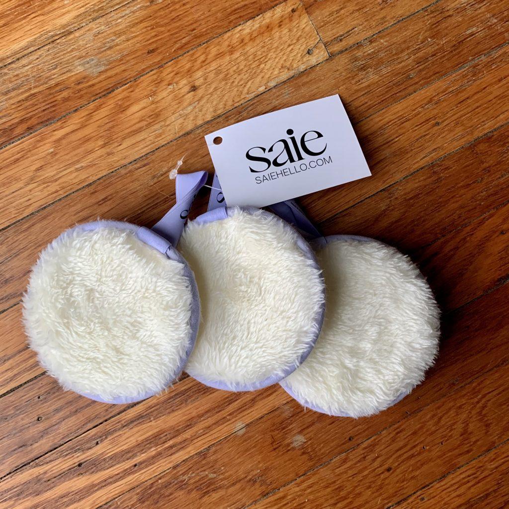 Three purple fuzzy cotton pags