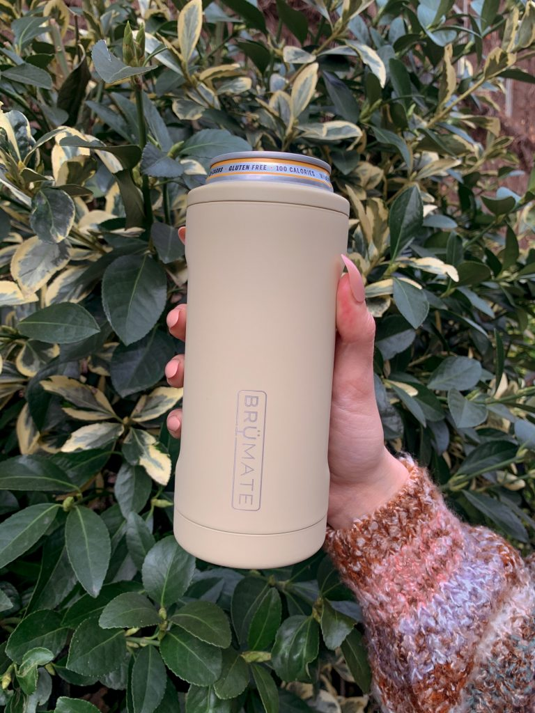Brumate review: hand in front of plants holding hopsulator slim