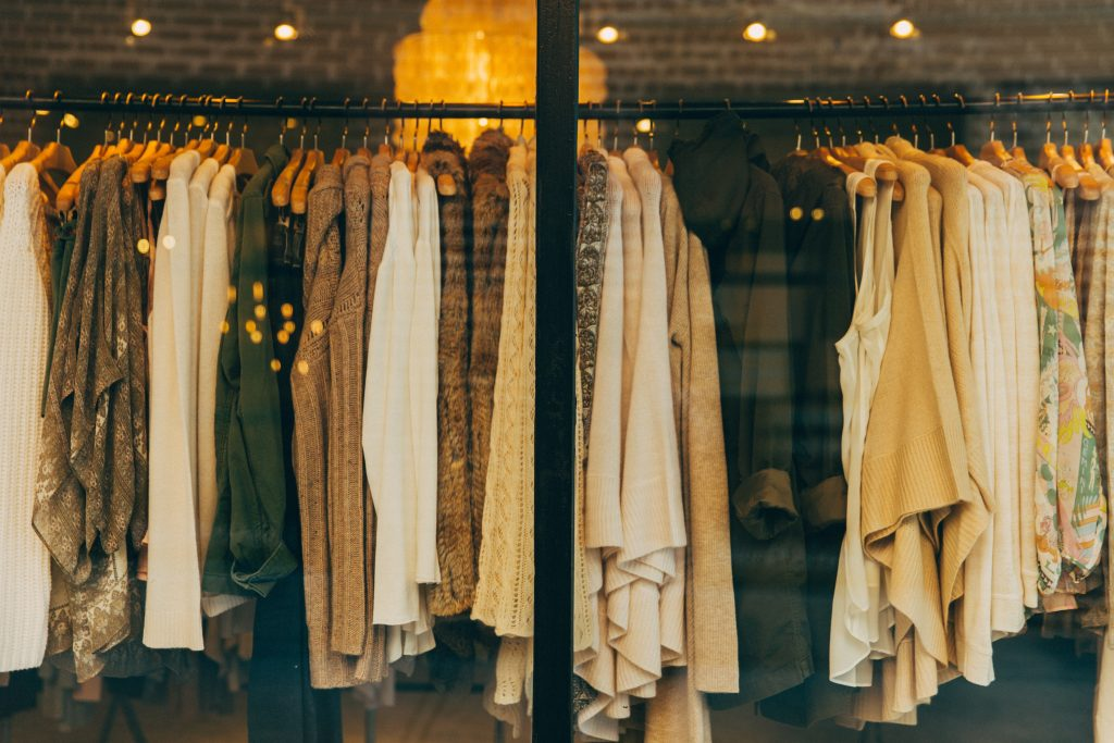 Clothings on a rack in a window for article Brands Like Urban Outfitters