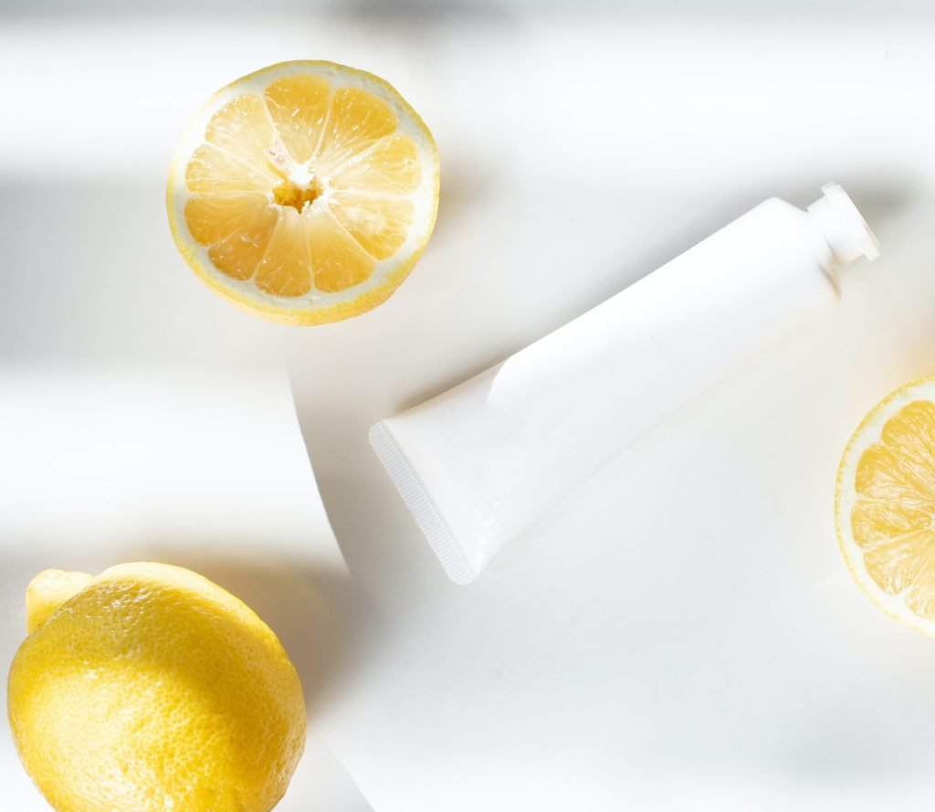 Image of white skincare bottles and lemons for sustainable skincare brands article