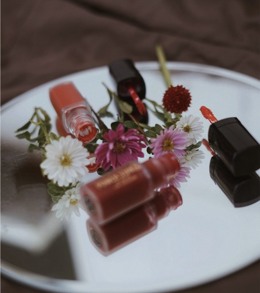 Lip gloss on tray with flowers for best drugstore lip glosses article