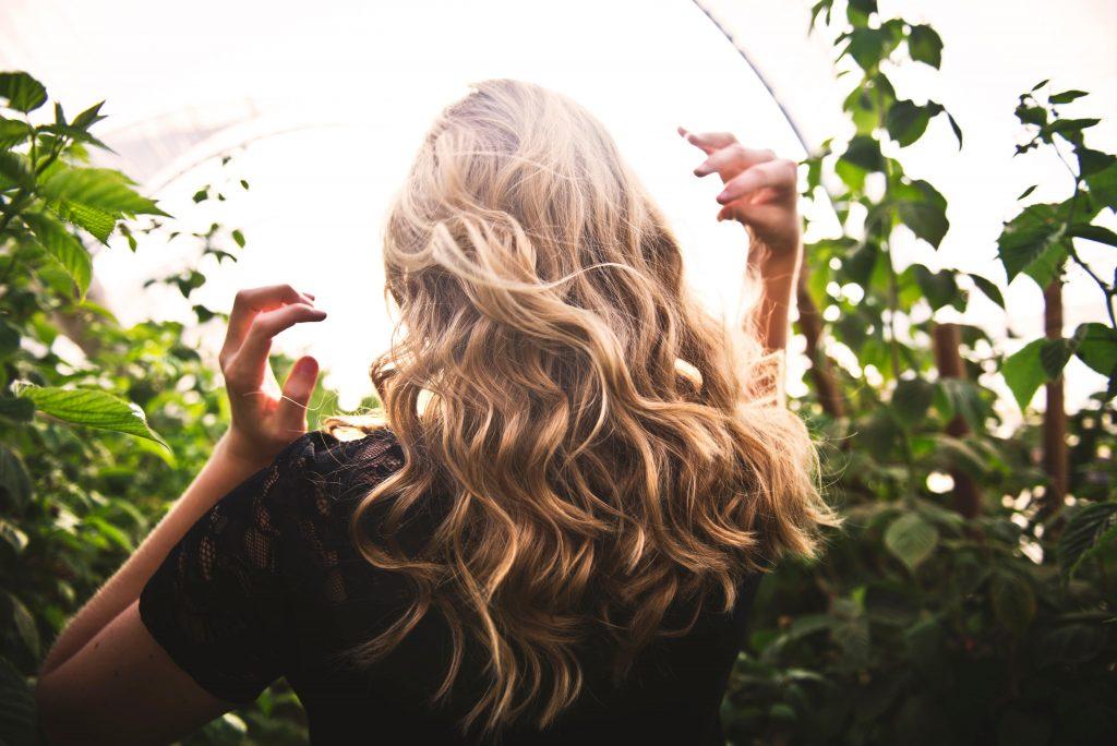 Girl in field for best drugstore hairspray article